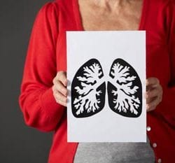 Senior woman holding ink drawing of lungs