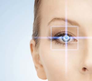 Digital white square and cross of blue light over a woman's eye.